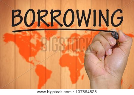 Hand Writing Borrowing Over Blur World Background