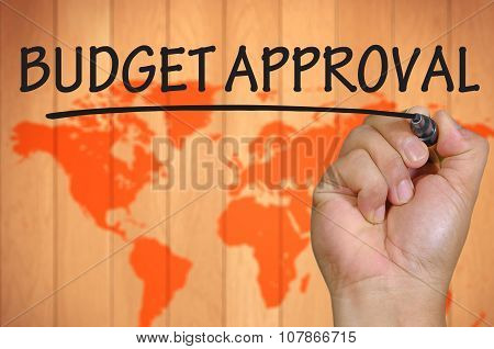 Hand Writing Budget Approval Over Blur World Background