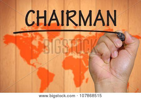 Hand Writing Chairman  Over Blur World Background