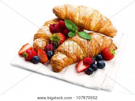 Fresh Tasty Croissants With Berries On White Background
