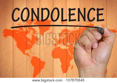 Hand Writing Condolence Over Blur World Background