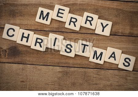 Merry Christmas Spelled Out In Tan Tile Letters