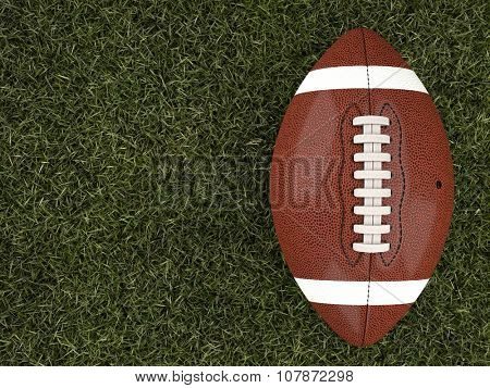 american football ball on grass
