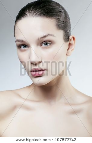 young sweet brunette woman close up isolated on white background, perfect pure innocense