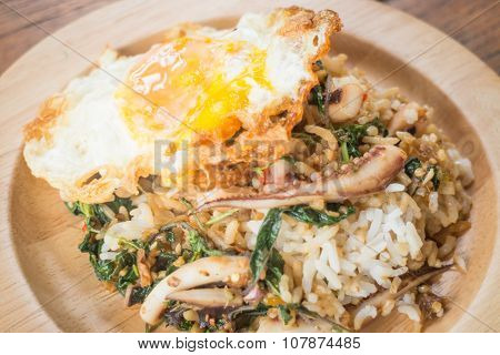 Rice Topped With Stir-fried Squid Basil And Fried Egg (thai Food)