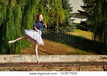 Hipster Ballerina Dancing In Autumn Park.
