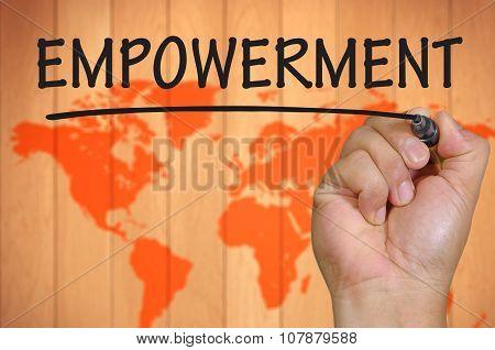 Hand Writing Empowerment Over Blur World Background