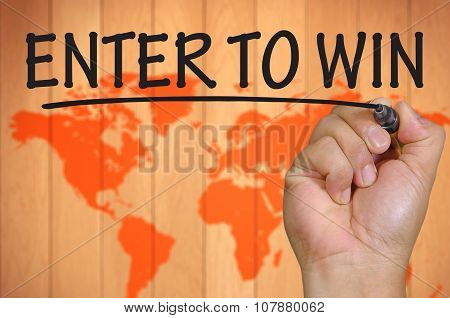 Hand Writing Enter To Win Over Blur World Background