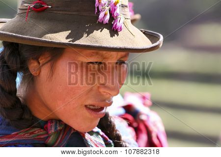 PISAC PERU - MARCH 5 2006: Unidentified woman at Inca citadel in Sacred Valleyl near Pisac in Peru. Sacred Valley of the Incas is a valley in the Southern Sierra that contains many famous and beautiful Inca ruins