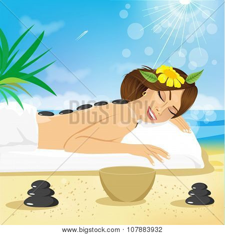 woman getting hot stones treatment