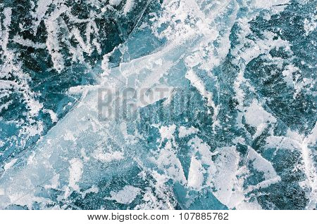 Blue Ice With Cracks And Bubbles On The Frozen Lake.