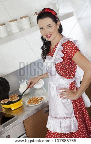 Young Housewife Baking Waffles