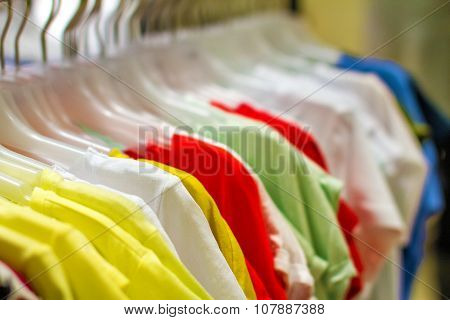 Women's Shirts Hanging On A Hanger In The Storec