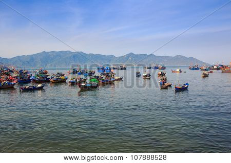 Large Group Of Vietnamese Fishing Boats In Azure Sea