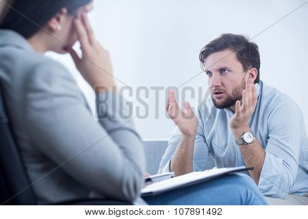 Angry Man Talking With Psychiatrist