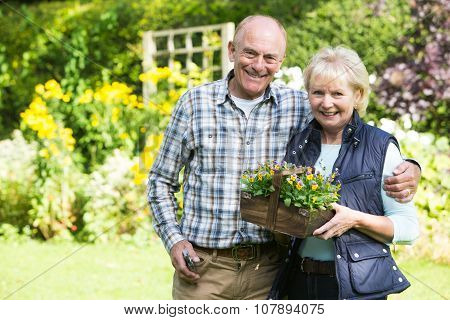 Portrait Of Senior Couple Working In Garden Together