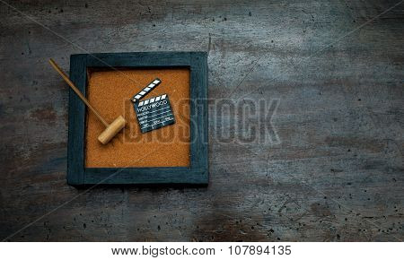 Zen Garden With Rake And Movie Clapper Board