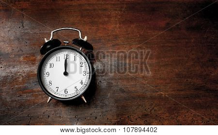 Classic Alarm Clock Noon Time On Wood
