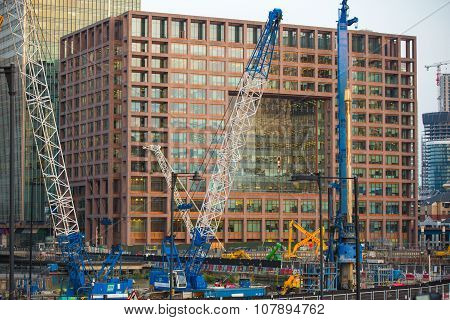 Building construction site with cranes and industrial units  in Canary Wharf aria