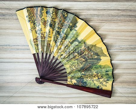 Traditional Eastern Fan With Painted Artistic Pattern