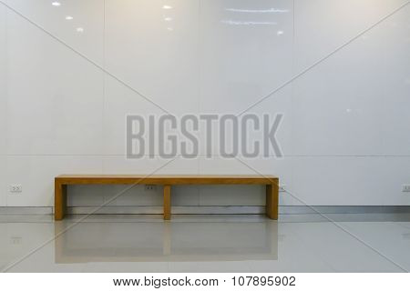 Wooden Seat Beside Th E White Wall