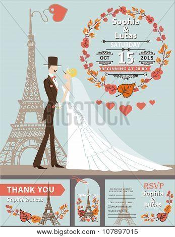 Wedding invitation.Groom,bride,Eiffel tower,autumn wreath