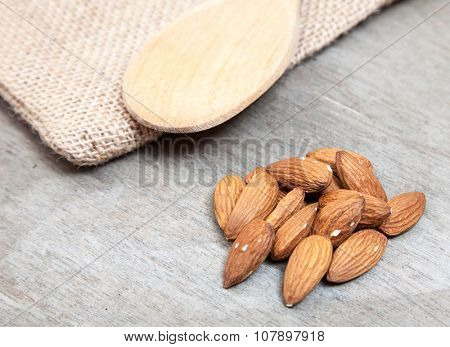 Fine almonds on wooden background