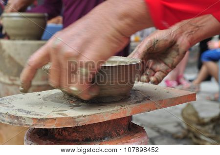 Nha Trang, Vietnam - July 11, 2015: An Old Woman Is Performing The Ceramic Molding Techniques At The
