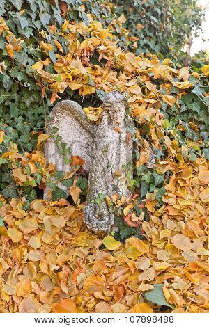 Statue Of An Angel In Yellow Leaves Near Sedlec Ossuary