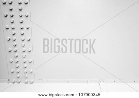 White Steel Wall With Bolts In A Row, Metal Parts