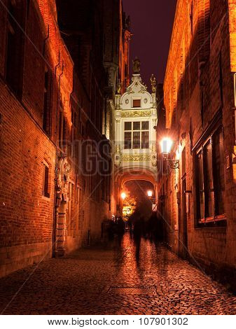 Blinde-Ezelstraat street in Bruges by night.