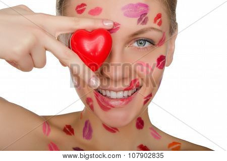 Young Woman With Kisses On Face Holding Heart Eyes