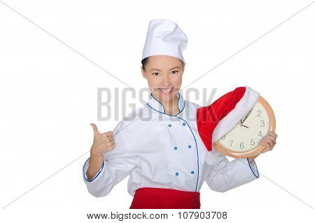 Beautiful Asian Chef With Clock And Christmas Hat