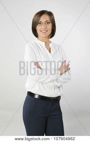Young Woman In Business Clothes Crossed Arms On Chest