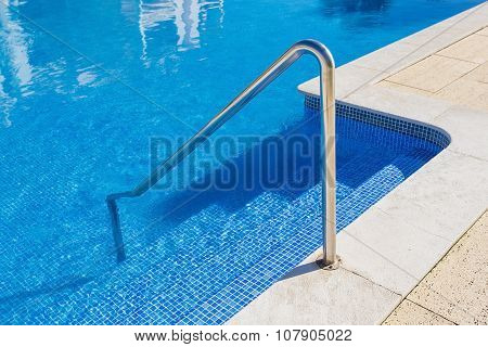 Detail Of The Steps Of The Pool. Handrails Of Metal.