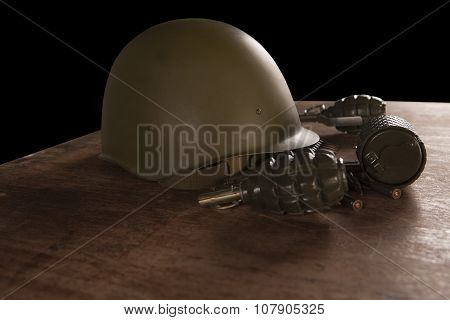 Military Helmet, Hand Grenades And Bullets On Table