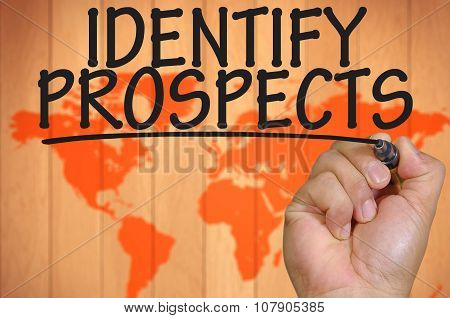 Hand Writing Identify Prospects Over Blur World Background
