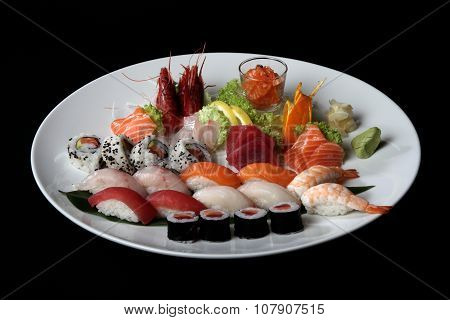 round plate of sushi and sashimi