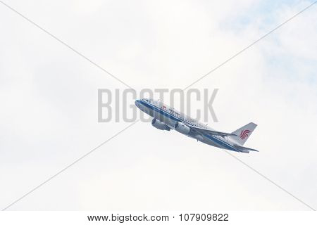 KATHMANDU, NEPAL - MARCH 2, 2014: Air China Airbus A319-115 after taking off from Tribhuvan International Airport.