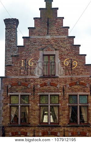 Architectural Facade Detail At One Old Building Placed In Bruges, Belgium, Of The 1669
