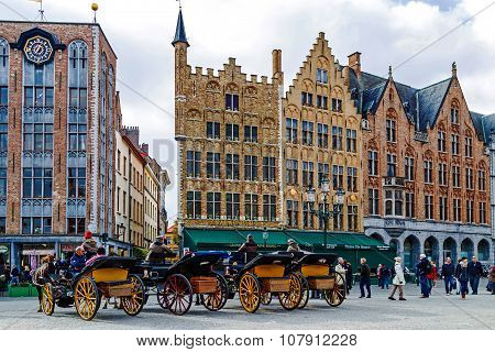 Horse-drawn Carriage With Tourists In Grote Markt, Brugge, Belgium