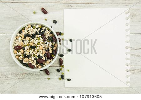 Recipe paper and cereal Grains on wood table.