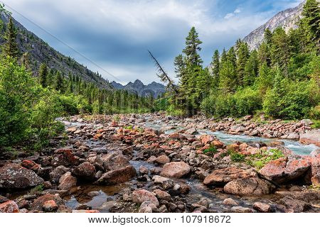 Siberian Mountain River In Early July