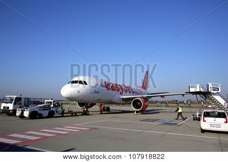 BUDAPEST, HUNGARY - NOVEMBER 1, 2015: An EasyJet airplane sits on the tarmac at the airport in Budapest, Hungary. EasyJet is a British low-cost airline carrier.
