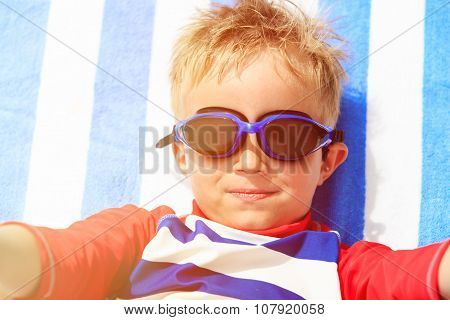 selfie of cute happy little boy at beach