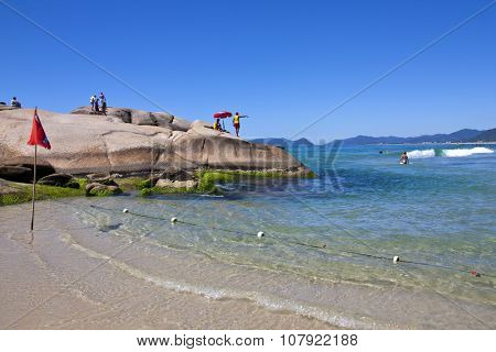 Florianopolis, Santa Catarina, Brazil - January 18, 2010: Brazilian beach called Joaquina located in Florianopolis city in Santa Catarina state with lifeguards watching tourists and surfers in water.