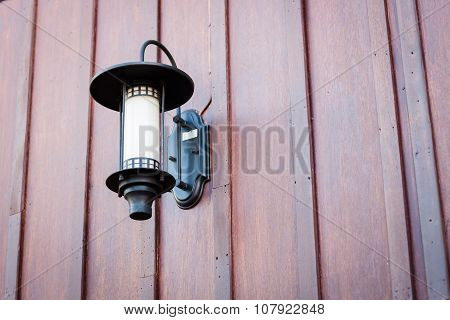 Lamp Decorated On Wooden Wall