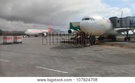 PLAINE MAGNIEN, MAURICIUS - NOVEMBER 3, 2015: Maintainance unit preparing Boeing B777 300/200 LR  Air Mauritius for flight on SSR International Airport. Modern aircraft for 550 passengers.