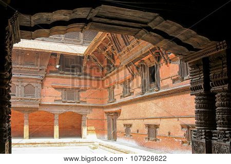 KATHMANDU, NEPAL - APRIL 2014 : Details of hand crafted wooden pillars, door and windows at Hanuman Dhoka, Old Royal Palace in Kathmandu, Nepal on 12 April 2014