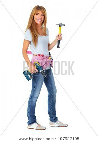 Woman with hammer and drill. House renovation and construction.